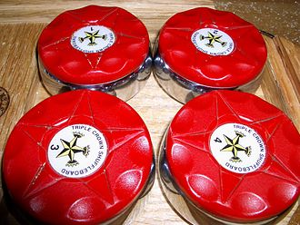 Table shuffleboard - A set of pucks