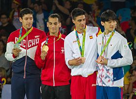 Taekwondo at the 2016 Olympics, Men's 68 kg podium.jpg