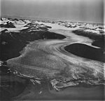 Taku Glacier, braided stream and tidewater glacier terminus in the foreground, and firn line in the background, August 31, 1977 (GLACIERS 6231).jpg