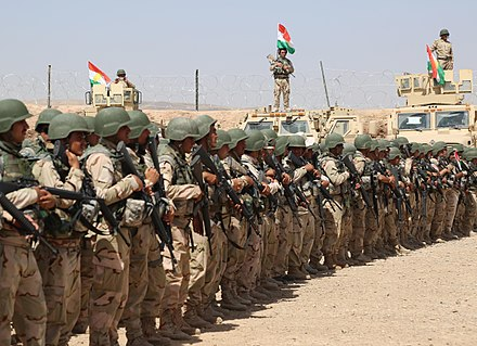 Peshmerga soldiers stand in formation during the Modern Brigade Course graduation ceremony. Task Force Talon advises, assists Ministry of Peshmerga July 28, 2016.jpg