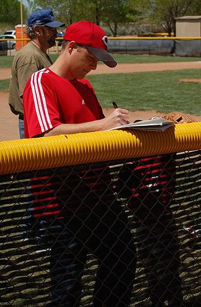 File:Tee Ball Coach Setting Lineup 2010.JPG