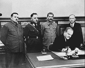 Andrei Zhdanov - The Soviet leadership signed a treaty with the Finnish Democratic Republic. Standing, from left to right are Andrei Zhdanov, Klim Voroshilov, Stalin, and Otto Kuusinen. Seated is Vyacheslav Molotov.