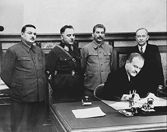 Otto Wille Kuusinen - The Soviet leadership signed a treaty with the Finnish Democratic Republic. Standing, from left to right are Andrei Zhdanov, Kliment Voroshilov, Stalin, and Kuusinen. Seated is Vyacheslav Molotov.