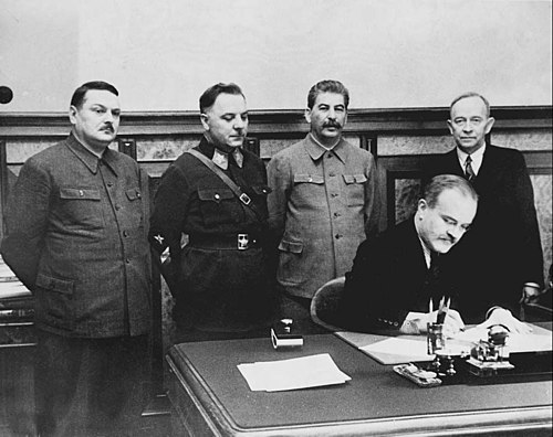Molotov signing a deal between the Soviet Union and the short-lived puppet state Finnish Democratic Republic, which existed on occupied territories during the Winter War. Terijokipakten.jpg