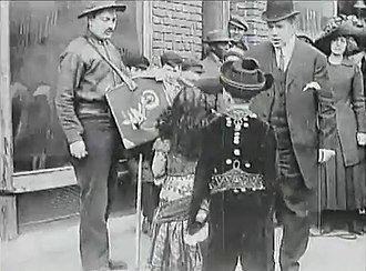 The Actor's Children - The theater manager rescues the children from the organ grinder