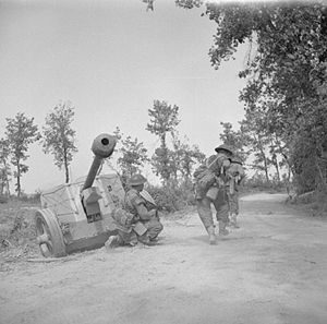 8th Infantry Division (India) - Men of 'A' Company of the 5th Battalion, Queen's Own Royal West Kent Regiment advance along a road past an abandoned German 75mm anti-tank gun in the Rapido bridgehead, Italy, 16 May 1944.