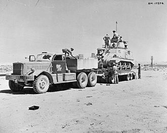 Tank transporter - Britsh Army M19 Tank Transporter, composed of an M20 tractor unit and M9 semi-trailer loading a Grant tank in North Africa
