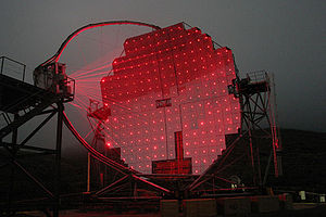 IACT - MAGIC, a Cherenkov telescope in operation on the Canary island of La Palma. On foggy nights, the lasers that are used to focus the mirrors can be seen.