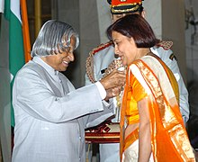 The President, Dr. A.P.J. Abdul Kalam presenting Padma Shri to Smt. Madhumita Bisht, badminton player, at investiture ceremony in New Delhi on March 29, 2006.jpg
