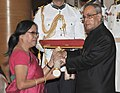 The President, Shri Pranab Mukherjee presenting the Padma Shri Award to Dr. Sarungbam Bimola Kumari Devi, at a Civil Investiture Ceremony, at Rashtrapati Bhavan, in New Delhi on April 08, 2015.jpg