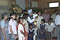 The Prime Minister Dr. Manmohan Singh with the children who tied Rakhi to him during the auspicious occasion of 'Raksha Bandhan', in New Delhi on August 19, 2005.jpg