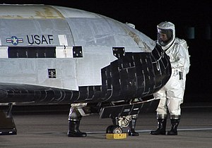 The X-37B OTV is inspected after landing at Vandenberg Air Force Base, California.jpg