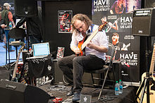 The amazing Alex Hutchings doing this thing at the Laney booth - 2014 NAMM Show.jpg