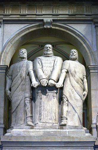 Eidgenossenschaft - The Three Confederates (1914), monumental statue by James Vibert in the Federal Palace of Switzerland.