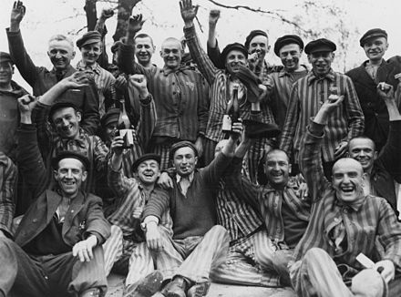 Polish prisoners toast their liberation from Dachau. Nazi persecution of Catholics was at its most severe in occupied Poland. Toasting Polish Dachau.jpg