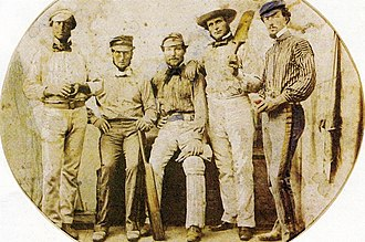 Wills (far right) with professional members of the Victoria XI, 1859. He preferred the company of professionals in an era when they were shunned by amateurs of his social stature. Tom Wills Victorian cricketers 1859.jpg