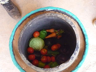 Pot-in-pot refrigerator - A clay pot cooler filled with vegetables