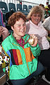 Tracy Lee Barrell holding Barcelona 1992 Paralympic medal.jpg