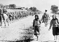 Troops of the 49th Guards Rifle Division marching, Moldova, late August 1944.jpg