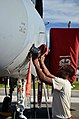U.S. Air Force Senior Airman Giovannie Robinson, a tactical aircraft maintainer with the 18th Maintenance Squadron, removes the protective cover from an F-15 Eagle aircraft Aug. 27, 2013, at Andersen Air Force 130827-F-NA975-007.jpg