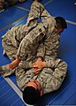 U.S. Air Force Senior Airman Robert Segovia, bottom, a heating, ventilation and air conditioning journeyman with the 380th Expeditionary Civil Engineer Squadron, attempts to perform an arm bar on Senior Airman 140110-F-XR500-281.jpg