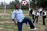 U.S. Air Force Staff Sgt. David Wilson, a noncommissioned officer in charge of training with the 376th Expeditionary Logistics Squadron, juggles a soccer ball at the Ozyornoe School in Kyrgyzstan Sept 120903-F-KX404-061.jpg