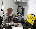 U.S. Army 1st Sgt. Michael Treanor, with the 63rd Civil Support Team, Oklahoma Army National Guard, monitors command and control traffic at the Emergency Operations Center in Moore, Okla., May 21, 2013 130521-Z-VF620-802.jpg