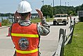 U.S. Army Spc. Felix Mendoza, left, a cargo specialist with the 390th Seaport Operations Company directs an operator of a Humvee for pre-load inspection training at the Vissering Landship Training Facility 130730-A-DU750-006.jpg