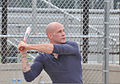 U.S. Coast Guard Petty Officer 3rd Class Christopher Yaw, a public affairs specialist with the 9th Coast Guard District External Affairs Office in Cleveland, swings at a pitch during his unit's softball 130731-G-KB946-009.jpg
