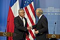 U.S. Defense Secretary Chuck Hagel shakes hands with Chilean Defense Minister Jorge Burgos at the end of a joint press conference in Santiago, Chile 141011-D-DT527-568c.jpg