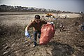 U.S. Marine Corps Lance Cpl. Martin K. Hernandez Barajas, with the III Marine Expeditionary Force Headquarters Group, picks up trash as voluntary community service in support of exercise Ssang Yong 14 at Ocheon 140328-M-MO123-035.jpg