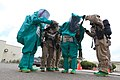 U.S. Marine Corps chemical, biological, radiological and nuclear (CBRN) defense specialists with Marine Wing Headquarters Squadron (MWHS) 3, 3rd Marine Aircraft Wing, suit up in level B hazardous material suits 130430-M-EF955-319.jpg