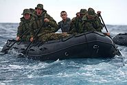 U.S. Marines aboard a combat rubber raiding craft