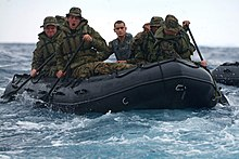 U.S. Marines aboard a combat rubber raiding craft.jpg