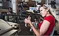 U.S. Navy Gunner's Mate 1st Class Max Gassant, left, and Gunner's Mate 3rd Class Matthew McGuinness show Lt. Corinne Devin, Ms 121220-N-WX059-080.jpg