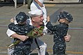 U.S. Navy Ship's Serviceman 1st Class Chris Wiese, assigned to the guided missile destroyer USS Momsen (DDG 92), greets his children on the pier at Naval Station Everett, Wash., Aug. 22, 2013 130822-N-MM360-159.jpg