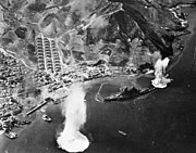 Haruna anchored near the shore, shortly after two aerial-dropped bombs narrowly missed her