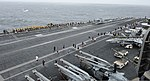 U.S. Sailors and Marines take part in a 5K run on the flight deck of the aircraft carrier USS Nimitz (CVN 68) Aug. 18, 2013, in the U.S. 5th Fleet area of responsibility 130818-N-IB033-202.jpg
