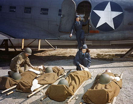 At the AAF School of Air Evacuation at Bowman Field, Ky., student flight nurses learned how to handle patients with the aid of a mock-up fuselage of a Douglas C-47 transport. USAAF Flight Nurses during WWII.jpg