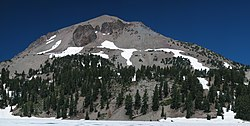 Conical baren peak with rock outcrops