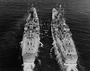 USS Boston (CAG-1) and USS Canberra (CAG-2) underway in the Caribbean Sea on 22 April 1958 (NH 98289).jpg