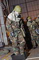 US Air Force (USAF) personnel, 100th Air Refueling Wing (ARW), Royal Air Force (RAF) Mildenhall, United Kingdom (UK), in full Mission-Oriented Protective Posture response level 4 (MOPP-4) gear, stop at a 031112-F-HL961-007.jpg