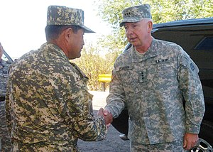 Armed Forces of the Republic of Kazakhstan - Gen. Maj. Adilbek Aldaberpenov (left), Kazakhstan Airmobile Forces commander, greets Lt. Gen. William G. Webster, Third Army/U.S. Army Central commanding general, 2009