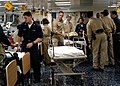 US Navy 030315-N-4048T-123 Medical personnel attend to patients in one of the medical triage rooms aboard the amphibious assault ship USS Kearsarge (LHD 3).jpg