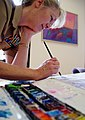 US Navy 030318-N-9643K-001 Navy Artist Cmdr. Monica Allen, U.S. Navy Reserves, applies the first dabs of paint to a penciled sketch while painting images of troops in action in the Mediterranean Area of Operations.jpg