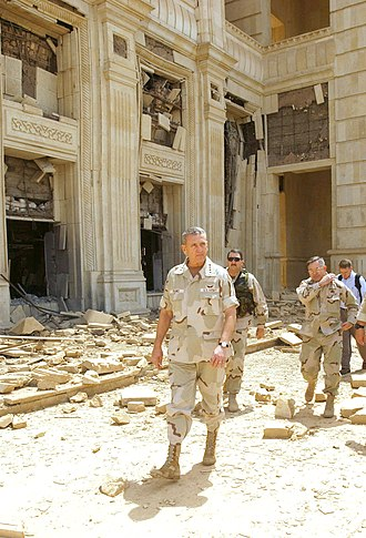 Tommy Franks - Franks touring one of Saddam Hussein's palaces in April 2003