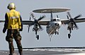 US Navy 040219-N-5821P-005 An E-2C Hawkeye makes an arrested landing aboard the aircraft carrier USS Kitty Hawk (CV 63).jpg