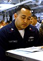 US Navy 040304-N-7986B-065 Personnelman 2nd Class Jose Martinez reviews a questionnaire prior to taking the semiannual First Class Petty Officer (E-6) advancement examination.jpg