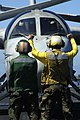 US Navy 040522-N-5781F-008 An aircraft director gives the single to the pilot of an S-3B Viking to stop.jpg