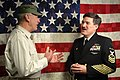 US Navy 050211-N-0962S-003 Master Chief Petty Officer of the Navy (MCPON) Terry Scott speaks to R. Lee Ermey in the Navy Operations Center at the Pentagon.jpg